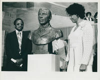 George Washington Carver bust with guests