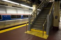 Pennsylvania Station, interior of station, brass handrails on train platform.