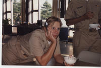 Female student in khaki uniform, ice cream
