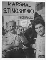 Man carrying sign Marshal S. Timoshenko