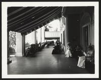 Palm Beach Hotel, partially enclosed sitting area, undated [circa 1900-1910].