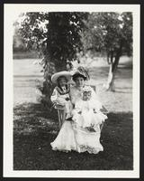 Palm Beach Hotel, unidentified woman sitting outdoors with children, undated [circa 1900-1910].