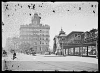 Greeley Square, with an elevated train station, the Union Dime Savings Bank and a statue of Horace Greeley visible, New York City, 1901. Emulsion damage.