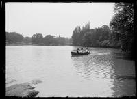 Unidentified people in a rowboat in Central Park, New York City, undated (ca. 1890-1900).