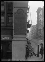 Bronze plaque marking the site of the Merchants Coffee House, New York City, undated (ca. 1914-1919).