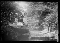 Unidentified women and man in  Central Park by a stream, New York City, 1882.