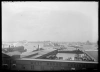 View of spectators on the Hudson River piers and battleships on the river for the Dewey Naval Parade, New York City, September 29, 1899.