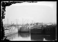 Boats moored in an unidentified  canal basin, New York City (?), undated (ca. 1890-1919).