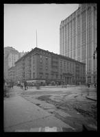 Astor House at the corner of Broadway and Vesey Street, with the base of the Woolworth Building at right, New York City, 1913.