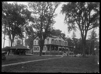 Unidentified inn or restaurant near a lake of ocean, possibly Marblehead, Massachusetts, undated (ca. 1882-1919).