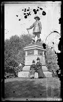 Two unidentified women pose beside the Pilgrim statue in Central Park, New York City, undated (ca. 1885-1895).