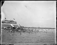 Beachgoers on Coney Island beach in front of Balmer's Bathing Pavilion, Coney Island, Brooklyn, August 6, 1898.