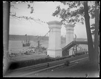 Viewing platform on the Hudson for the Hudson-Fulton Celebration, with the replica of the 'Half-Moon' in the river beyond, New York City, undated (ca. 1909).