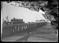 Crowds gathered on an unidentified pier, undated (ca. 1890-1905). Emulsion damage.