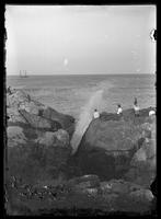 Holidaymakers seated on high rocks at the shore, Massachusetts (?), undated (ca. 1882-1905).