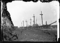 Ships docked, Marblehead Neck (?), Massachusetts, 1901. Emulsion damage.