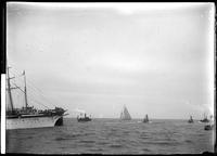 The yacht 'Defender' taking part in an ocean race (probably the Americas Cup),     1:17 p.m., September 7, 1895.