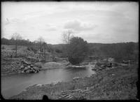 Construction site beside a wide stream, the Bronx, New York City, undated (ca.     1898).
