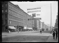 Unidentified intersection of West 44th Street, with Tammany banner for John E. Dordan strung across the avenue, New York City, 1905.