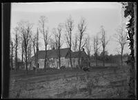 Old stone and shingle farmhouse surrounded by fields, Flushing, Queens, New York City, 1903.
