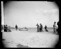 On the Sands': two girls in a boat on the beach, Coney Island, Brooklyn, New York City, 1891.