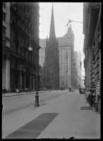 Broadway looking north past Trinity Church, New York City, undated (ca. 1890-1910).