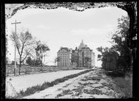 St. Luke's Hospital, W. 113th Street looking east, New York City, undated (ca. 1896-1919). Emulsion damage.