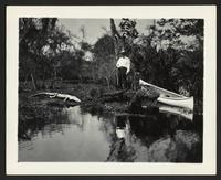 Unidentified man with canoe and dead alligator, undated [circa 1900-1910].
