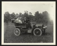 Unidentified family in automobile, undated [circa 1900-1910].