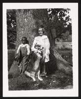 Unidentified children with dog, undated [circa 1900-1910].
