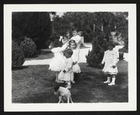 Unidentified children outdoors with dog, undated [circa 1900-1910].
