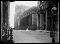 View along Wall Street to the U.S. Trust Building at 43 Wall Street; the National City Bank at 55 Wall Street; and the Atlantic Building, New York City, undated (ca. 1899-1919).