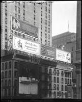 Fifth Avenue and E. 42nd Street, New York City, August 1921: Boyshform Brassiere, Bril Brothers (Kuppenheimer Clothes), National Surety Company, Charles Trey (hairdresser), Venus Pencils, Converse Tires. Also empty billboard and one being painted over.