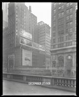 Fifth Avenue and 42nd Street, New York City, December 27, 1928: 'My Man' (motion picture), Armour Star Ham, Buick Cars, Miami (City of Miami Chamber of Commerce), The Roosevelt (car). Also 1 empty billboard and 1 being put up.