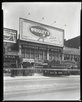 125th Street between Seventh Avenue and Lenox Avenue, New York City, July 25, 1928: Palisades Amusement Park (partial), Wrigley's Double Mint Gum. Also storefronts of Ideal Shoe Shop, Toby's Men's Shop, Christensen School of Music, Orient Photo Plays, Lei