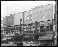 125th Street between Lenox Avenue and Seventh Avenue, New York City, May 1920: Brill Brothers, O-Cedar Furniture Polish. Also storefronts for Christensen School, Leight Bros. Outfitting Company, Sol Young (photographer), Alva Photo Shop, Royal Wearing App