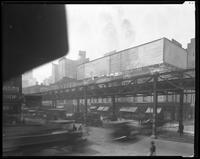 Sixth Avenue and West 47th Street, New York City, April 1925: 5 empty billboards.