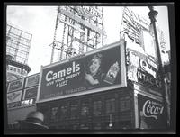 Broadway at West 47th Street, New York City, September, 1934: Camel Cigarettes, Coca-Cola (partial), Hexin, Schaefer Beer, Trommer's White Label Beer, Squibb's Dental Cream (partial).