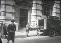 Armored car and detail of entrance to Guaranty Trust Company of New York, 522 Fifth Avenue between 43rd Street and 44th Street, 1937 or 1938.