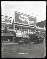 125th Street between Seventh Avenue and Lenox Avenue, New York City, February 27, 1928: Wrigley's Double Mint Gum, 'The Trail of '98' (motion picture). Also storefronts of Ideal Shoe Shop, Toby's Men's Shop, Christensen School of Rag and Jazz, Orient Phot