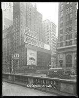 Fifth Avenue and 42nd Street, New York City, September 29, 1928: 'The Terror' (motion picture), Armour Star Ham, Buick Cars, Nestle's Circuline Wave. Also 4 empty billboards.