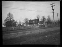 Flatlands: unidentified neighborhood with trolley tracks in foreground, undated.