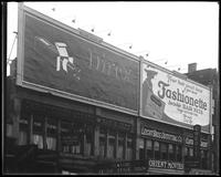 125th Street between Seventh Avenue and Lenox Avenue, New York City, May 1922: Direx Film, Fashionette Invisible Hairnets. Also storefronts of Ideal Shoe Shop, Christensen School of Rag and Jazz, Orient Movies, Leight Brothers Outfitting Company.