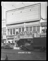 125th Street between Seventh Avenue and Lenox Avenue, New York City, January 31, 1934: 1 empty billboard, Cadillac Cars (partial). Also storefronts of Tip Top Shoe Shop, Orient Photo Plays.