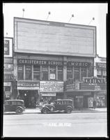 125th Street between Seventh Avenue and Lenox Avenue, New York City, June 30, 1932: 1 empty billboard.  Also storefronts of Tip Top Shoe Shop, Christensen School of Music, Orient Photo Plays.