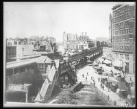 Broadway looking north from 33rd Street at the intersection of Sixth Avenue, New York City, showing the elevated station; copy negative after original photograph by an unknown photographer, 1880s.