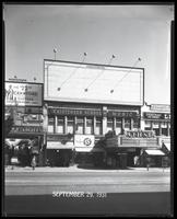 125th Street between Seventh Avenue and Lenox Avenue, New York City, September 29, 1931: Crawford Custom Quality Clothes. Also storefronts of Tip Top Shoes, Christensen School of Music, Orient Photo Plays. Also 1 empty billboard.