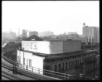 El tracks above Eighth Avenue and West 110th Street, looking southwest, New York City, circa 1921: Lion Brewery, Live Leather Belt.