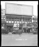 125th Street between Seventh Avenue and Lenox Avenue, New York City, November 27, 1931: Crawford Custom Quality Clothes (partial).  Also storefronts of Tip Top Shoes, Christensen School of Music, Orient Photo Plays, 1 empty billboard.