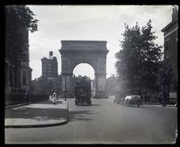 Fifth Avenue near 8th Street, looking south towards Washington Square Arch, with pedestrians and double decker bus, New York City, circa 1921.